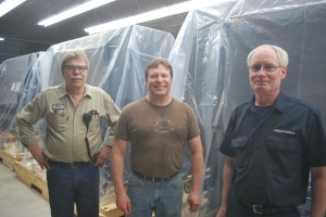 (Left to right) WORZALLA maintenance technician Barry Neumann, press operator Todd Obremski, and Heidelberg install technician Mike Sullivan welcome the first of five truckloads of XL106 press components.